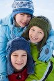 Enfants heureux en hiver Photos libres de droits