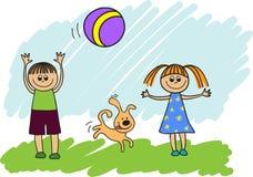 Enfants jouant avec une bille Photos stock