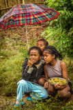 Enfants malgaches sous la pluie Photos libres de droits