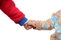 Enfants retenant leurs mains Images libres de droits
