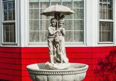 Enfants sous la pluie Photographie stock