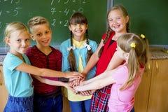 Enfants sur une leçon Photographie stock