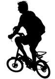 Enfants trois de cycliste Image stock