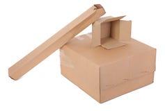 enferme dans une boîte le carton trois Images stock