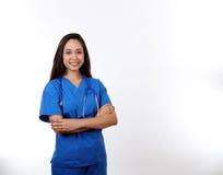 A enfermeira amigável no azul esfrega Fotos de Stock Royalty Free