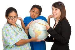 Enfermeira e professor que apontam ao mundo Imagem de Stock