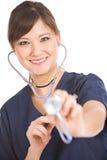 Enfermeira: A enfermeira com estetoscópio olha a câmera imagens de stock