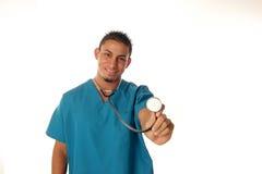A enfermeira escuta seu coração Fotografia de Stock Royalty Free