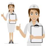 A enfermeira guarda o formulário e mostra o polegar acima Fotografia de Stock Royalty Free