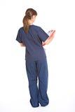 Enfermeira: Opinião traseira o doutor fotografia de stock royalty free