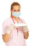 Enfermeira que guardara os tubos de ensaio vazios Fotografia de Stock Royalty Free