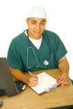 Enfermeira que trabalha em sua mesa Fotografia de Stock