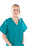 Enfermera aislada en blanco con el uniforme verde Imagen de archivo