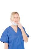 Enfermera aislada en el uniforme del azul del whitewith Foto de archivo libre de regalías