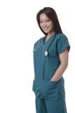 Enfermera asiática atractiva en scurbs Fotografía de archivo libre de regalías