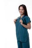 Enfermera bastante asiática con la expresión cómoda imagenes de archivo