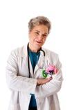 Enfermera cómoda sonriente feliz del doctor del pediatra Imagen de archivo