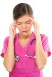 Enfermera con dolor de cabeza y la tensión Imágenes de archivo libres de regalías
