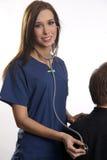 Enfermera con el estetoscopio Imagen de archivo libre de regalías