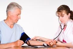 Enfermera con el paciente Fotos de archivo