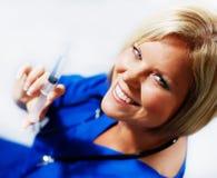 Enfermera con la jeringuilla Foto de archivo libre de regalías