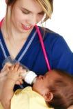 Enfermera con recién nacido Imagen de archivo