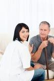 Enfermera con su paciente Imágenes de archivo libres de regalías