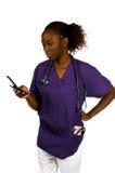Enfermera del teléfono celular fotos de archivo