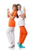 Enfermera dos que da vuelta a sus partes posteriores en una otras Foto de archivo libre de regalías