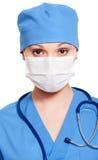 Enfermera en máscara y uniforme Foto de archivo