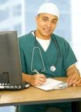 Enfermera feliz en su oficina Fotografía de archivo libre de regalías