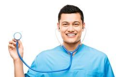 Enfermera médica que sonríe sosteniendo el estetoscopio Fotografía de archivo libre de regalías