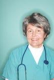 Enfermera mayor optimista Imagen de archivo libre de regalías