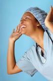 Enfermera muy emocionada Fotos de archivo