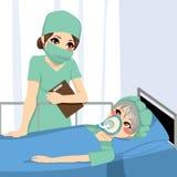 Enfermera And Patient del anestesista Imagen de archivo libre de regalías