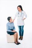 Enfermera que conforta a un paciente Imágenes de archivo libres de regalías