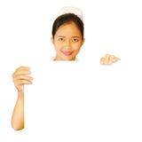 Enfermera que sostiene el cartel en blanco aislado Foto de archivo libre de regalías