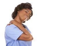 Enfermera que tiene un dolor de cuello Foto de archivo
