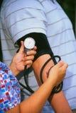 Enfermera que toma la presión arterial Imágenes de archivo libres de regalías