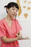 Enfermera Wearing Disposable Glove Imágenes de archivo libres de regalías
