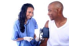 Enfermera y paciente imagen de archivo