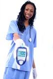 Enfermera y un palillo diabético del dedo Foto de archivo libre de regalías