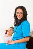 Enfermeras útiles con los pacientes Imágenes de archivo libres de regalías