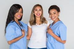 Enfermeras con un paciente Foto de archivo