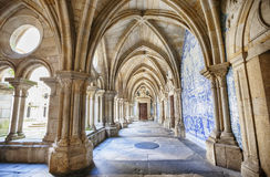 Enfilade of cathedral cloister Se, Porto, Portugal. Blue ceramic mosaic tiles by enfilade of cathedral cloister Se, Porto, Portugal Royalty Free Stock Image