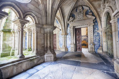 Enfilade of cathedral cloister Se, Porto, Portugal. Open door by enfilade of cathedral cloister Se, Porto, Portugal Royalty Free Stock Photo