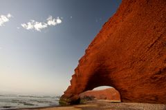 Enfilade of stone arch. Stone arch at Morocco. Amazing creation of waves and wind. Atlantic ocean. Legzira Stock Images