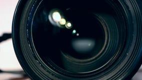 Enfoque de la lente de cámara almacen de video