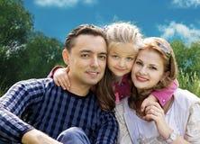 Enfrenta a família com a menina na colagem do parque imagens de stock royalty free