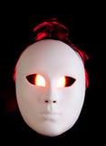 Eng wit masker met rode ogen Royalty-vrije Stock Fotografie
